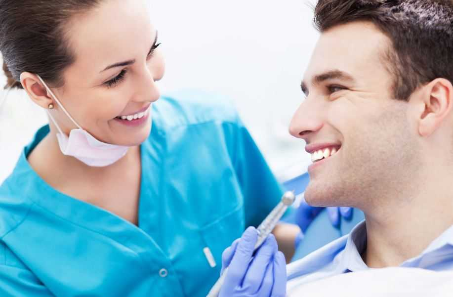 cosmetic dentist with patient