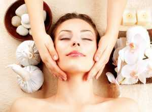 A woman enjoying a spa session at home