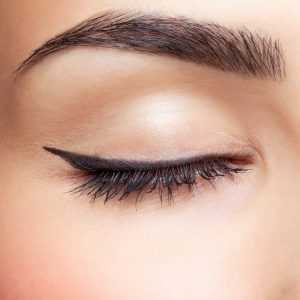 A closeup of a woman's closed eye