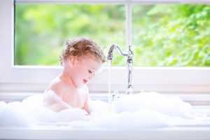 A Baby Taking A Bath