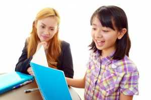 Girl studying second language with teacher