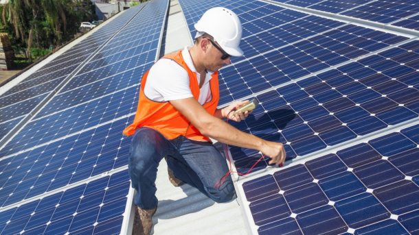 Technician Checking Solar Panels