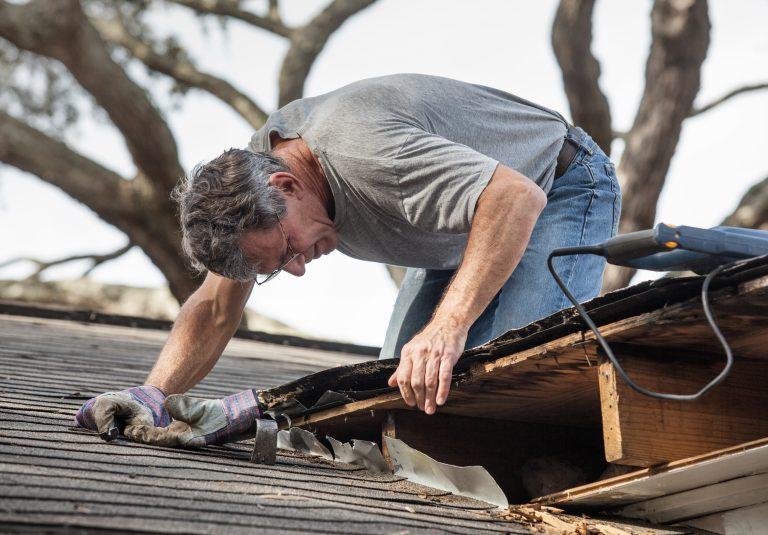 Man fixing a roof leak