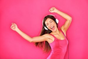 Girl in headphones singing