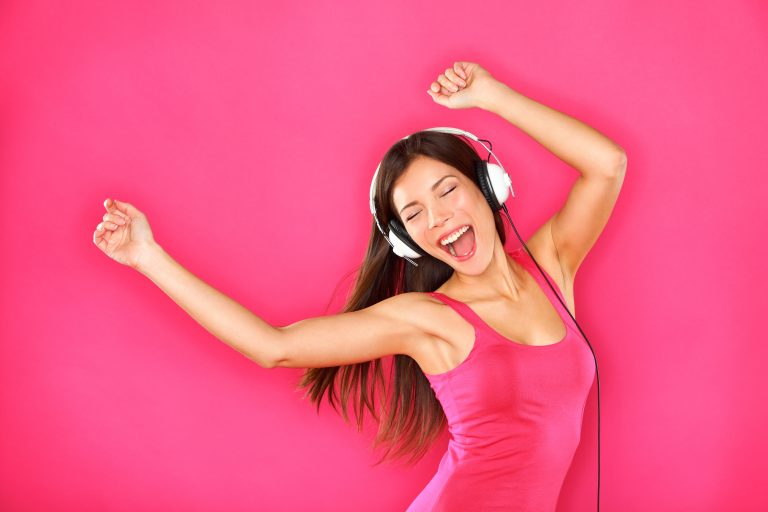 Girl in headphones singing