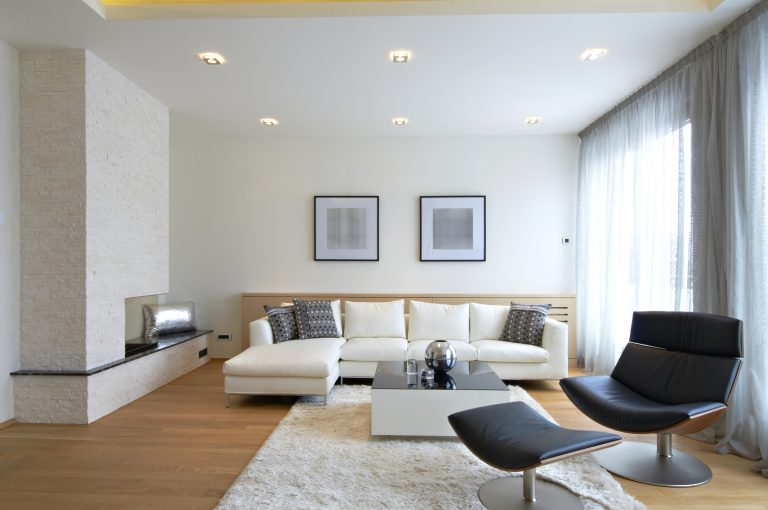 a minimalist, clean and modern living room with modern set of furniture