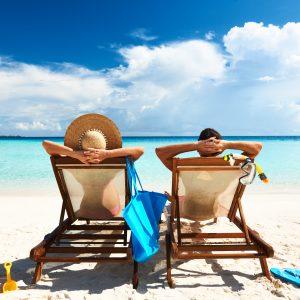 couple having a tan on their beach holiday