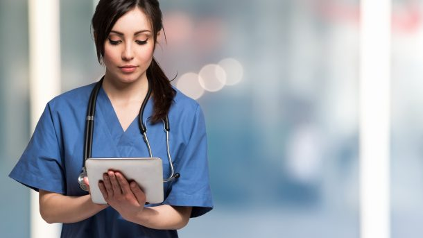 a night shift nurse looking at her tablet