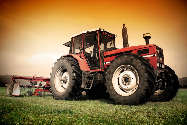 A tractor on a grass field
