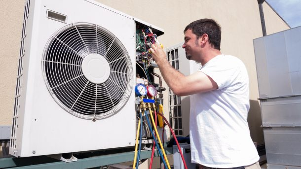 Man inspecting his HVAC system