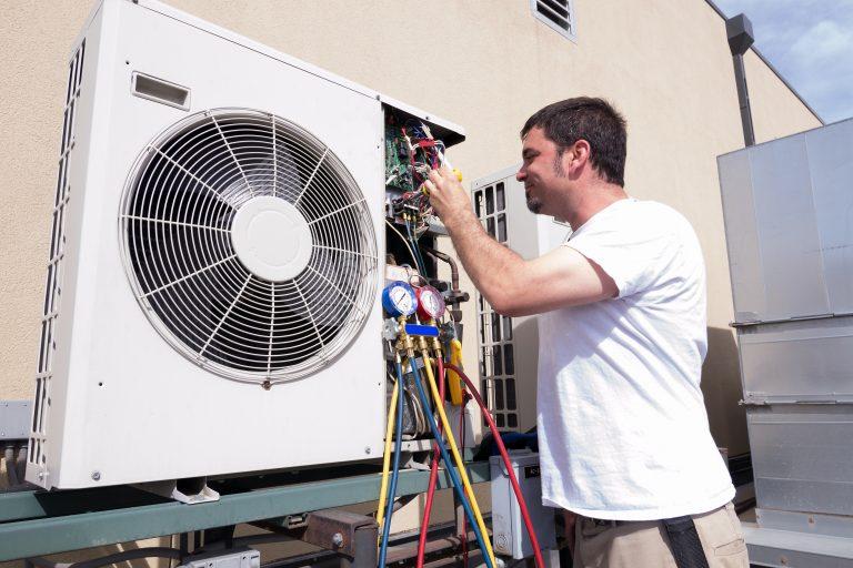 Man inspecting his HVAC system