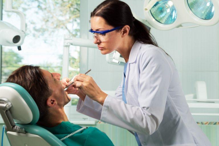 Dentist having oral procedure