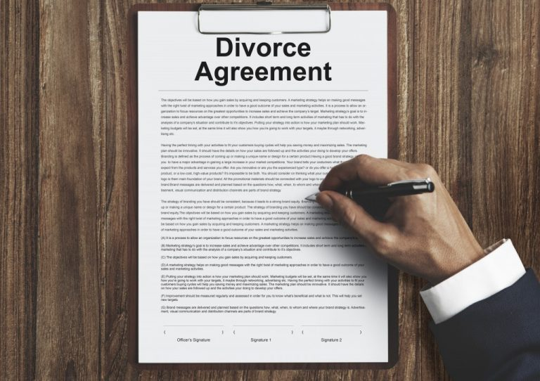 Man Signing a Divorce Agreement