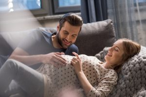 Husband touching wife's womb