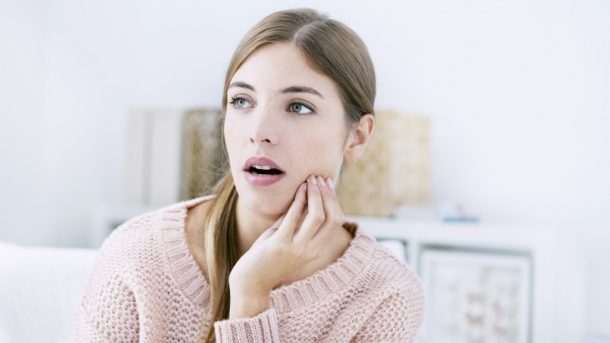 a woman experiencing a toothache