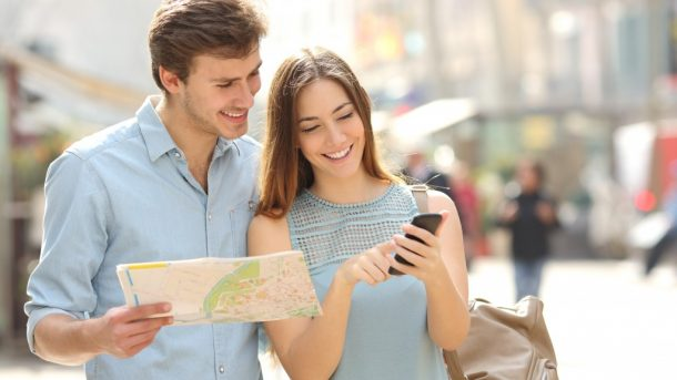 Couple accessing GPS on phone