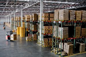warehouse workers inside big warehouse