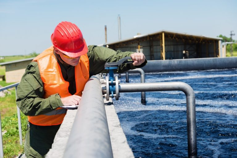 Man monitoring pipe water