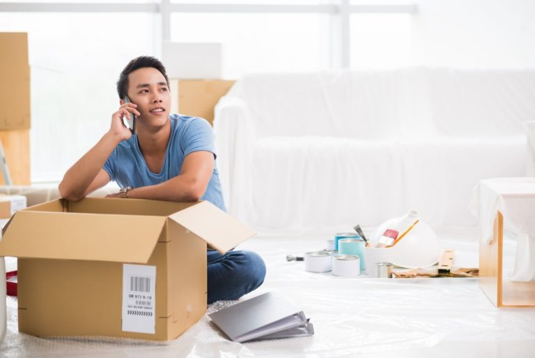 Man on the phone while packing