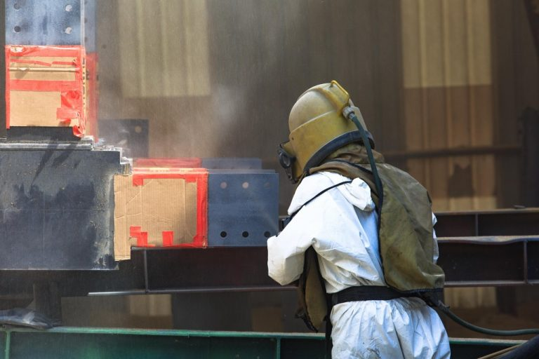 photo of a man sandblasting