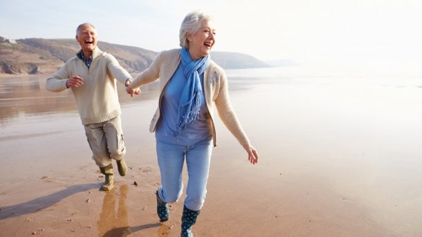 two happy old couple in the beach