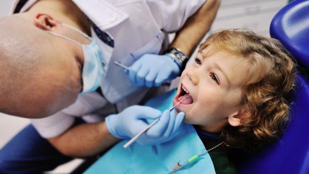 Dentist examines child's teeth