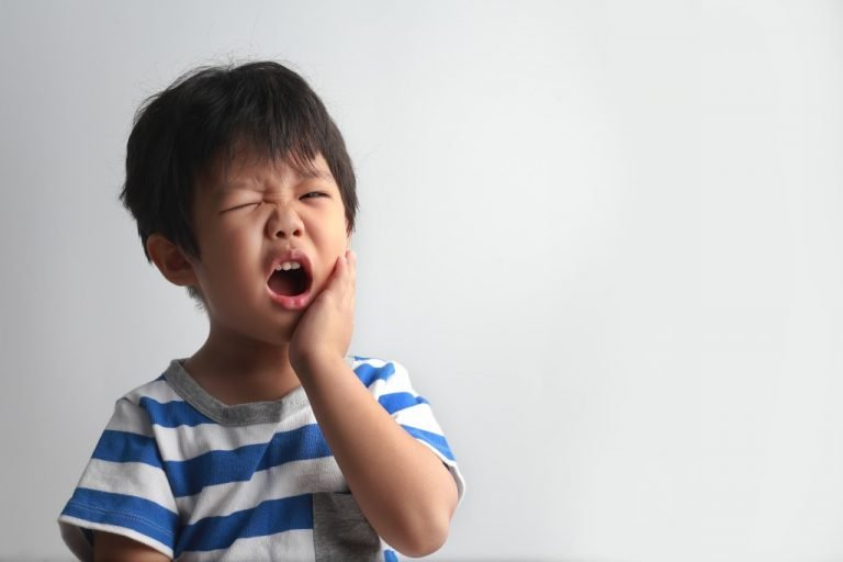 photo of a child with aching teeth