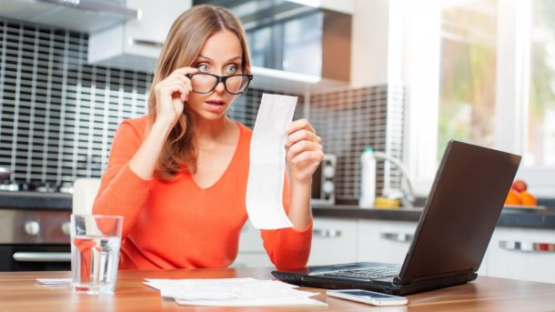 Woman in glasses shocked to see her bill