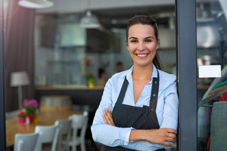 a restaurant owner in her own restaurant