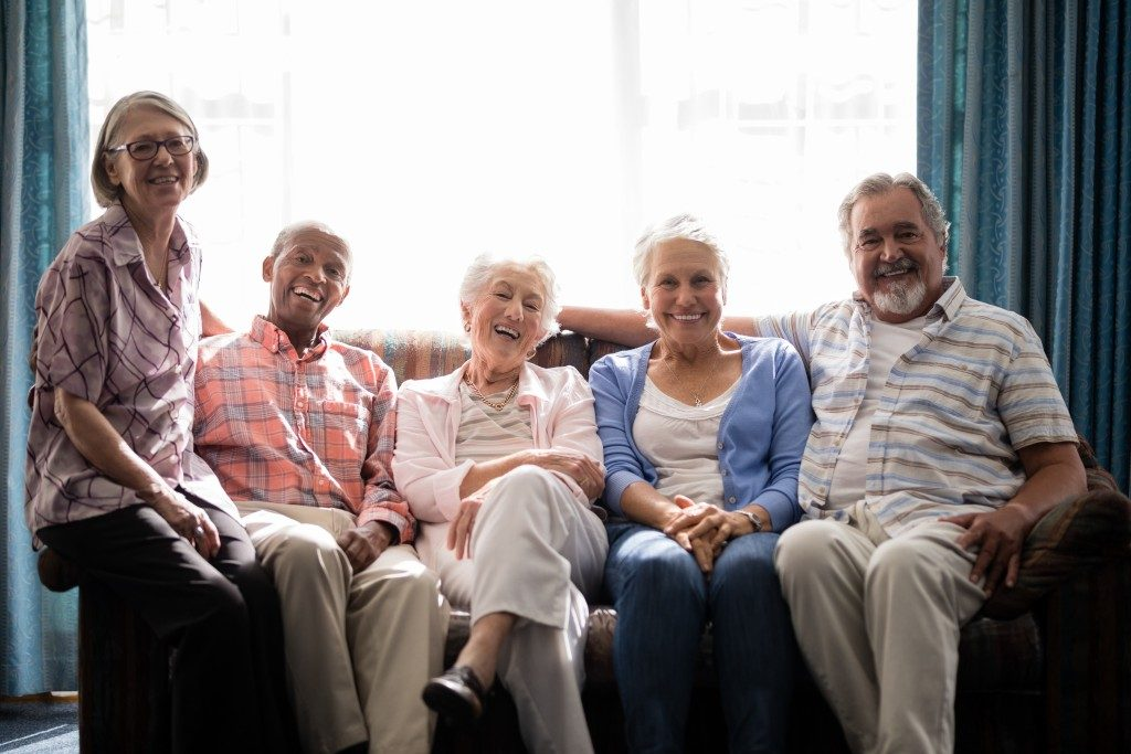 Elderly people sitting on a couch