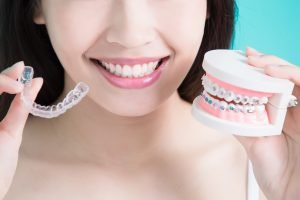 a woman with her Invisalign