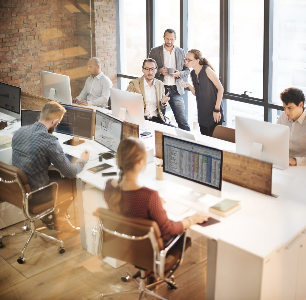 Employees discussing in the office