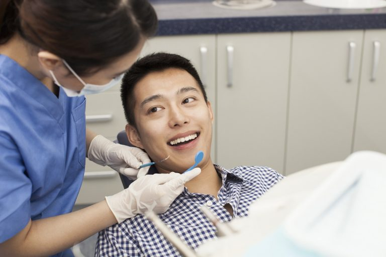 Dentist checking patient's teeth