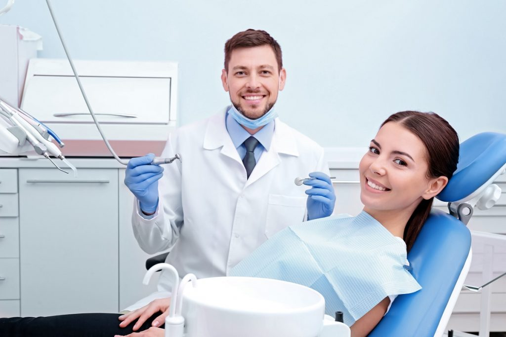 Dentist about to clean the patient's teeth