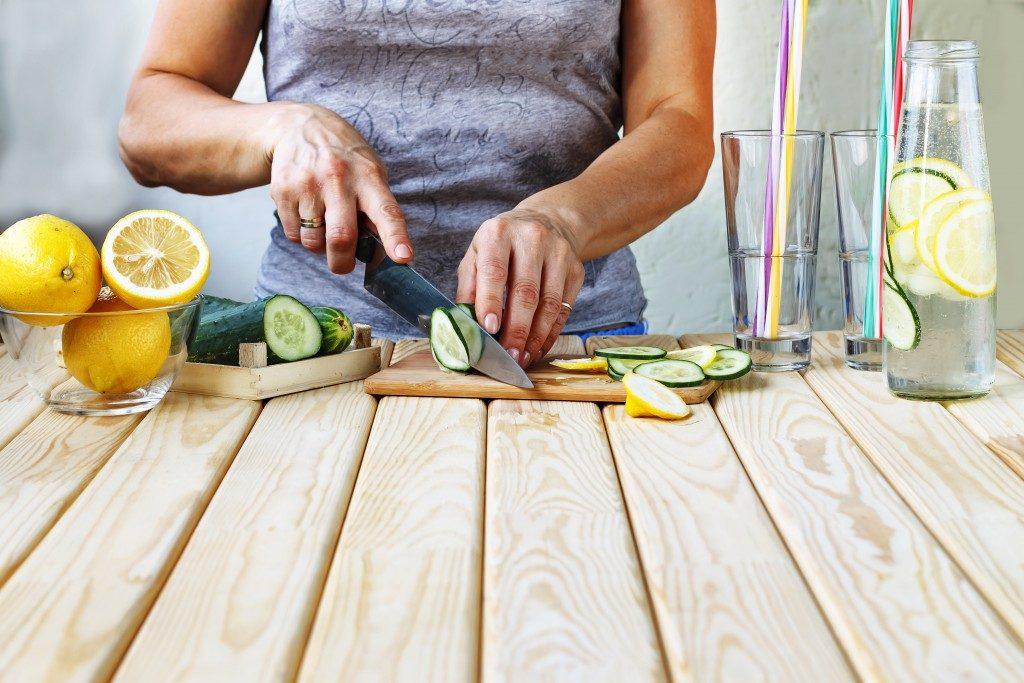 Woman preparing fruit juice