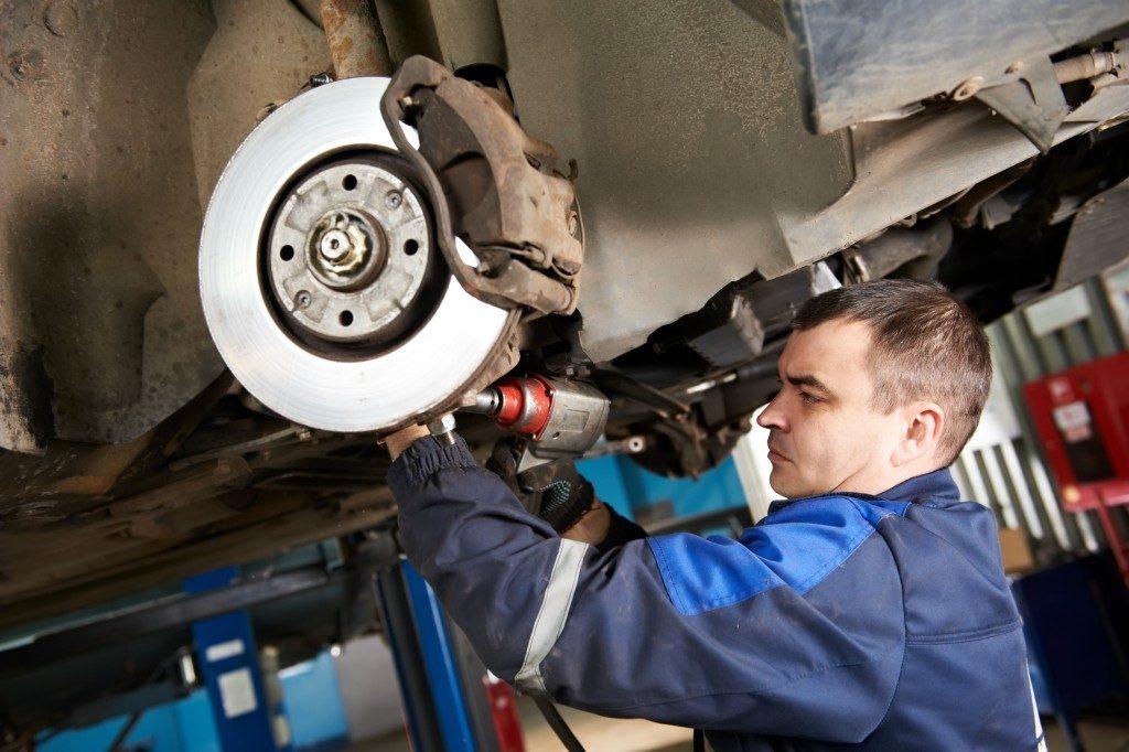Mechanic fixing the wheel section