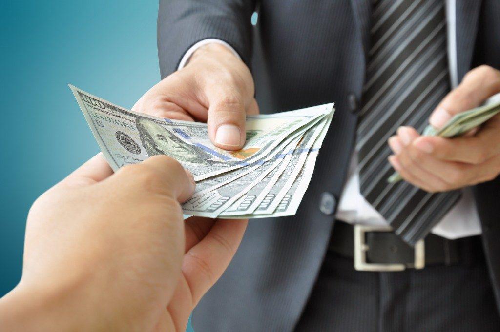 Businessman handing out money