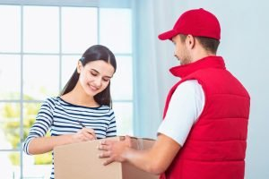 girl accepting a package from deliveryman