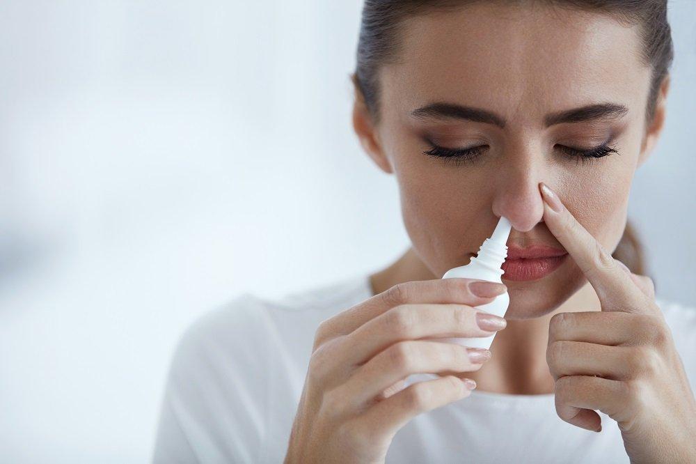 woman using nasal drip