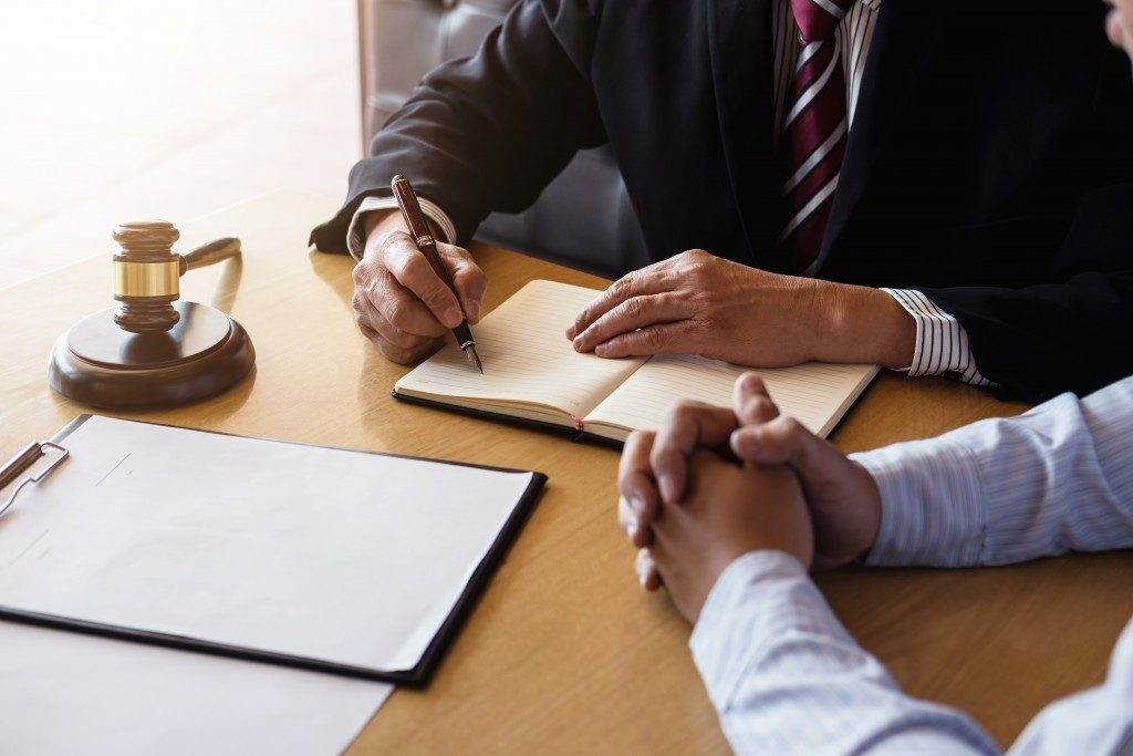 man consulting with a lawyer