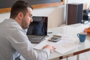 businessman looking at his financial statement