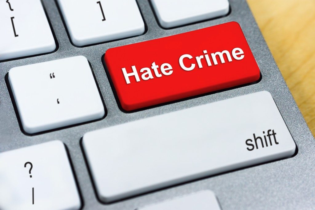 Written word Hate Crime on red keyboard button