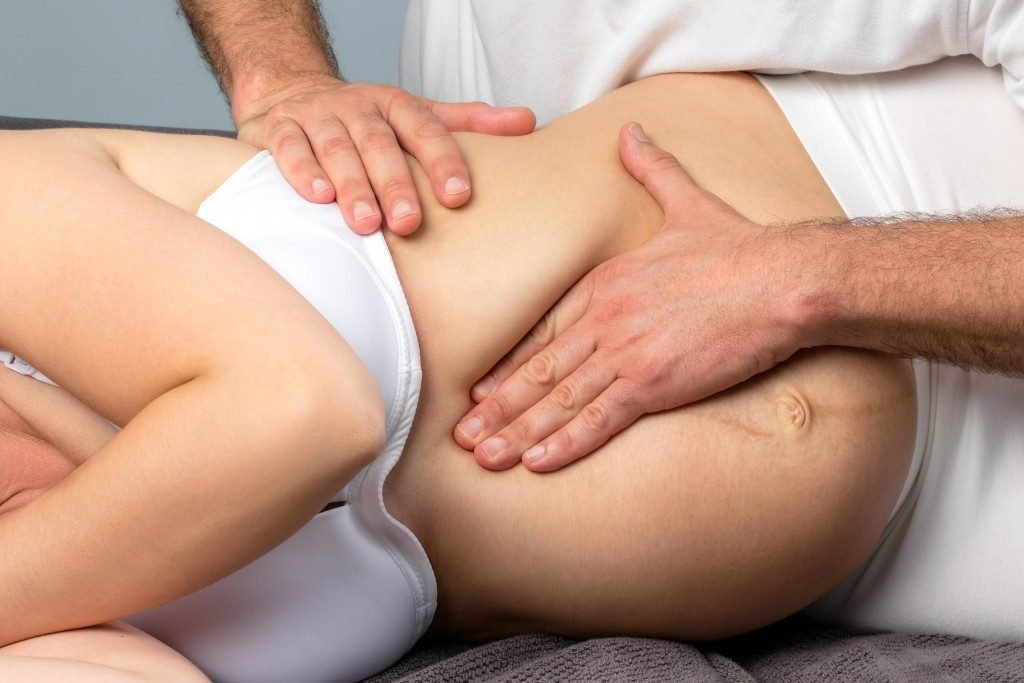 Pregnant woman getting a massage