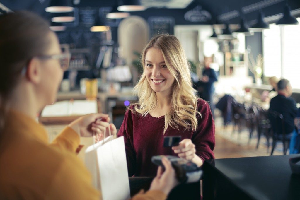 woman shopping using her credit card