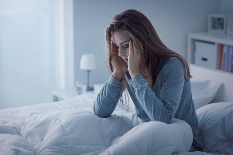 tired woman cannot fall asleep