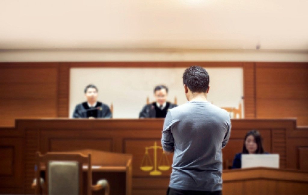 man in front of the judges inside a court room