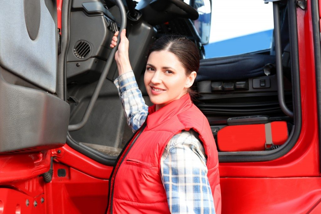 woman truck driver about to climb in the truck