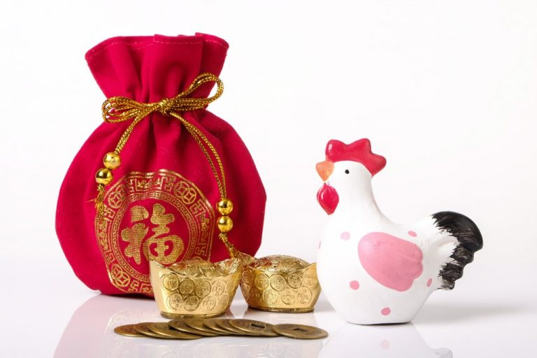 red money bag, gold and chinese coins on white background as New year concept