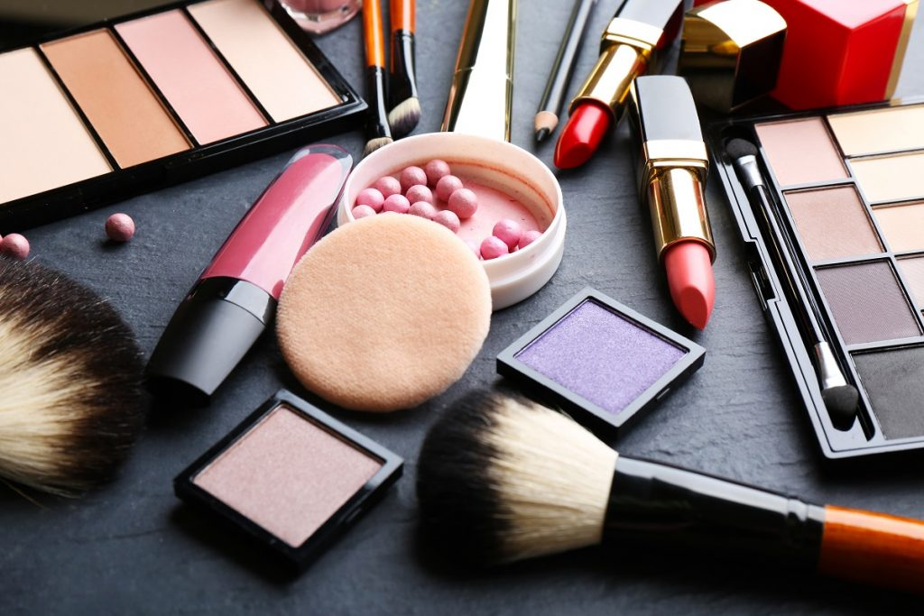 Make up, cosmetics scattered with black background