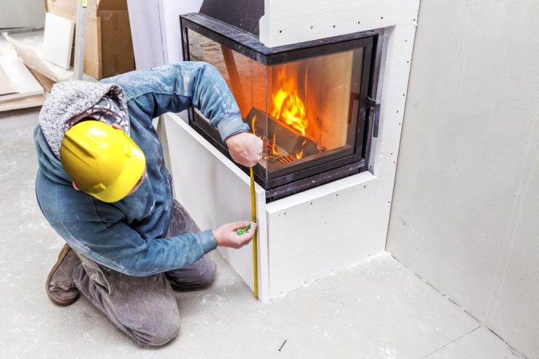 man measuring the fireplace